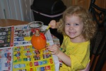 Painting her pumpkin from preschool