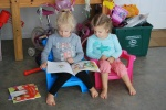 Reading to her sister