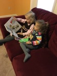 Abigail loves reading to siblings